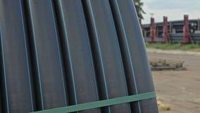 Entrepôt de dépôt industriel d'extérieur de tuyaux en plastique de finition Fabrication d'usine en plastique de conduites d'eau Photo stock