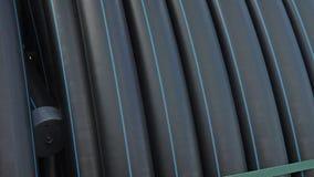 Entrepôt de dépôt industriel d'extérieur de tuyaux en plastique de finition Fabrication d'usine en plastique de conduites d'eau Image libre de droits