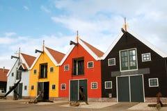 Entrepôts colorés dans le port hollandais Photos stock