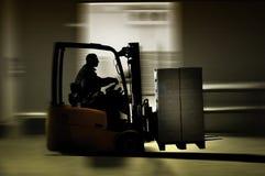 Entrepôt de Forklifter Photographie stock libre de droits