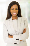 Entrepreneur with arms crossed. Cheerful african entrepreneur with arms crossed Royalty Free Stock Photography