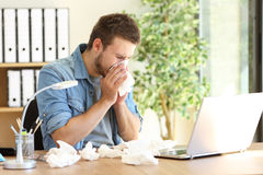 Entrepreneur blowing with a wipe at office Royalty Free Stock Images