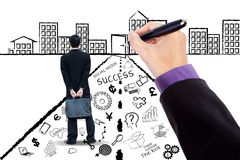 Entrepreneur with business doodles Royalty Free Stock Photo