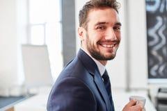 Entrepreneur businessman in a coffee break. With joy stock photos