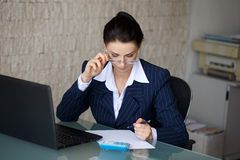 Entrepreneur calculating expenses Royalty Free Stock Photo
