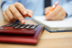 Entrepreneur calculating and reviewing investment plan Royalty Free Stock Images