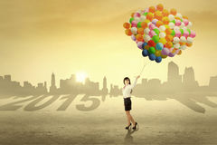 Entrepreneur carrying balloons outdoors Stock Photo