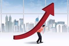 Entrepreneur carrying upward chart Stock Photos