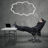 Entrepreneur with cloud tag and dreaming Stock Photo