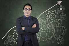 Entrepreneur with cog gear to success Stock Image