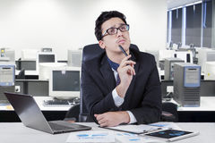 Entrepreneur concentrate to make an idea. Attractive young businessman working in the office while concentrate to find an idea Royalty Free Stock Photos