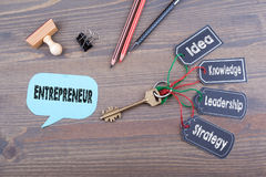 Entrepreneur concept. The key to success on a wooden office desk Royalty Free Stock Images