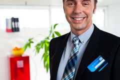 Entrepreneur with credit card in his blazer pocket Royalty Free Stock Photos