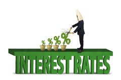 Entrepreneur cuts percentage signs of interest rates Stock Photography