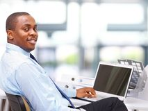 Entrepreneur displaying computer laptop Royalty Free Stock Images