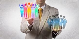 Entrepreneur Elevating Winning Multicultural Team. Unrecognizable entrepreneur elevating a cheering multicultural work team over a monocultural group of white royalty free stock images