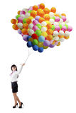 Entrepreneur holding colorful balloons Stock Photo