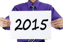 Entrepreneur holding number 2015 on a paper Stock Photography
