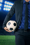 Entrepreneur holding soccer ball Royalty Free Stock Images