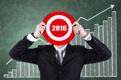 Entrepreneur holds dartboard with numbers 2016 Royalty Free Stock Photo