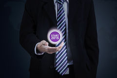 Entrepreneur holds a virtual number 2015 Stock Photo