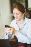 An Entrepreneur at Home with a Phone Stock Images