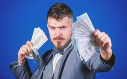 An entrepreneur or investor. Business startup loan. Rich businessman with us dollar banknotes. Currency broker with. Bundle of money. Bearded man holding cash royalty free stock photos