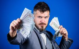 An entrepreneur or investor. Business startup loan. Rich businessman with us dollar banknotes. Currency broker with. Bundle of money. Bearded man holding cash stock images
