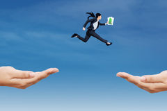 Entrepreneur jump through two hands Stock Photo