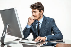 Entrepreneur looking at computer screen with horror Royalty Free Stock Images