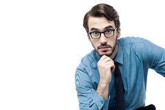 Entrepreneur lost in thoughts. Businessman thinking deeply with hand on chin Stock Photo