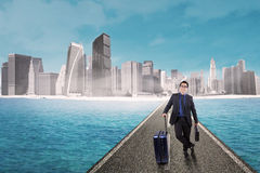 Entrepreneur with luggage doing business travel Royalty Free Stock Images