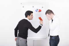Mananger showing red card to executive Stock Photography
