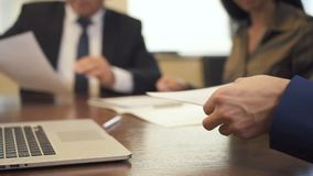 Entrepreneur and mature businessman signing contract on office desk. stock video footage