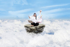 Entrepreneur multitasking above clouds Royalty Free Stock Photos