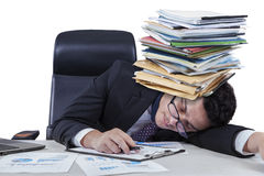 Entrepreneur nap with documents. Male employee sleeping on desk with paperworks on his head, isolated on white background Royalty Free Stock Photos