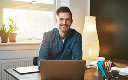Entrepreneur at office with laptop Stock Photography