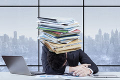 Entrepreneur with a paperwork pile in office Stock Images