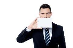 Entrepreneur positively holds blank card Stock Photography