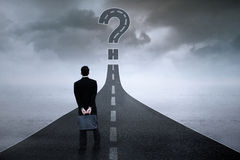Entrepreneur with question sign on the road royalty free illustration