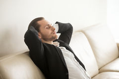 Entrepreneur resting at home after difficult day Stock Photos