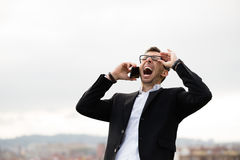 Entrepreneur shouting during business phone call Stock Photography