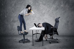Entrepreneur shouting to tired employee Stock Photo