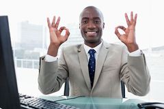 Entrepreneur signing that everything is perfect Royalty Free Stock Photos
