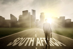 Entrepreneur with suitcase and South Africa word Stock Photos