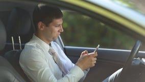 Entrepreneur surfing net on phone in car stock video