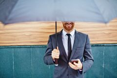 Entrepreneur under umbrella Royalty Free Stock Photo