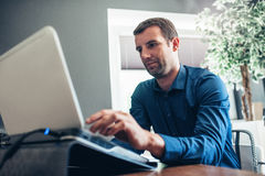 Entrepreneur using a laptop for business in an office Stock Photo