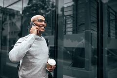 Entrepreneur using mobile phone while commuting to office Stock Photos