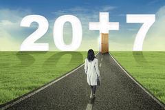 Entrepreneur walking on the road to number 2017 Stock Photos